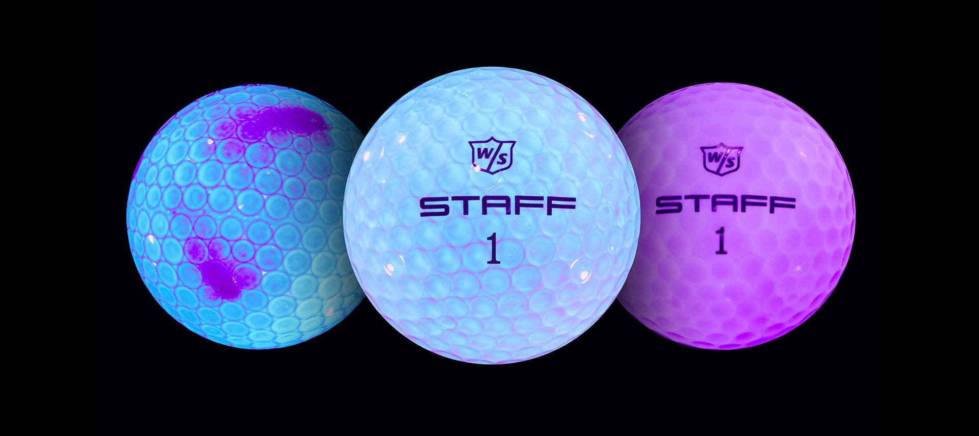 raw golf balls under black light