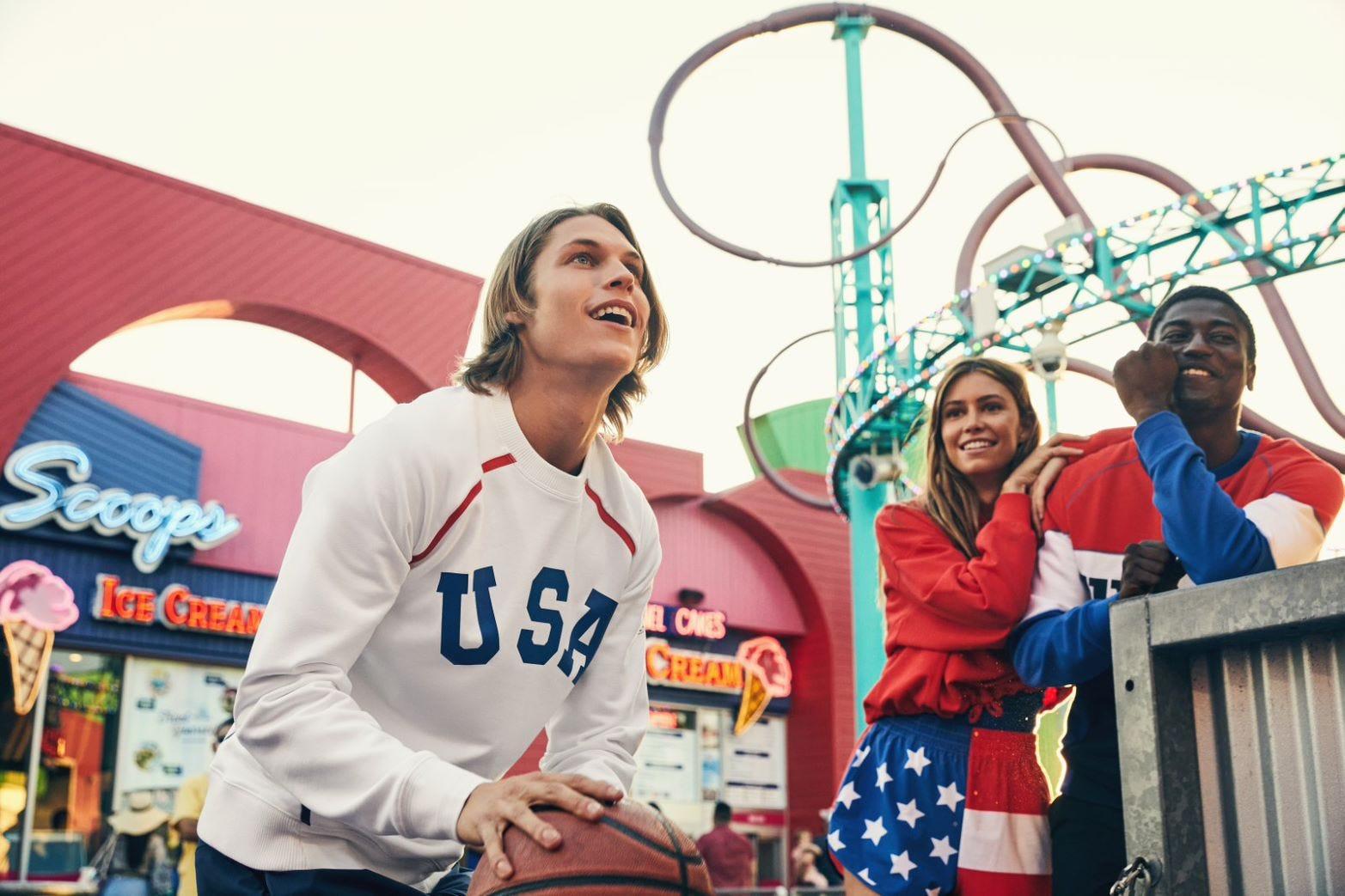 friends shooting hoops on a boardwalk