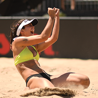 zana muno in the sand with her fists raised
