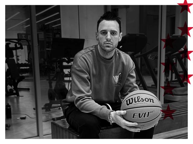 Chris Brickley holding a Wilson basketball