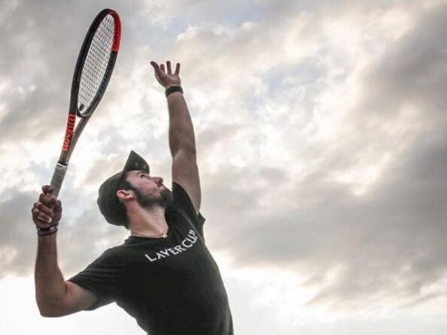 Player hitting tennis ball