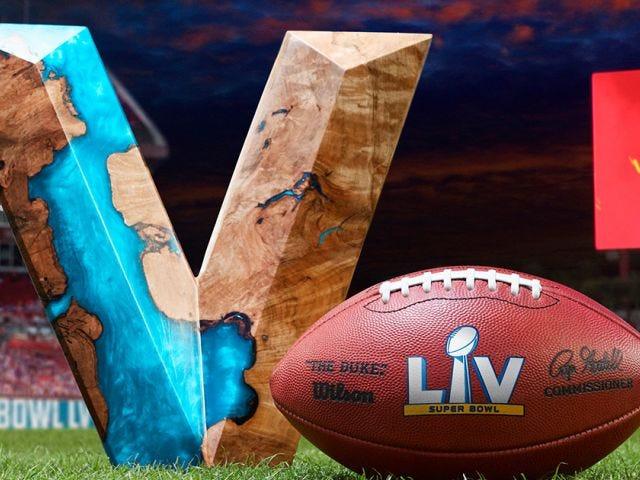 Super Bowl LV banner with Duke game ball