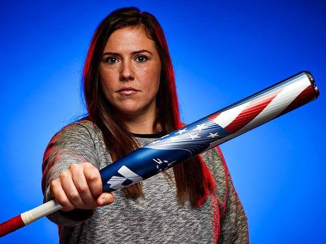 Amanda Chidester on blue background holding a fastpitch bat