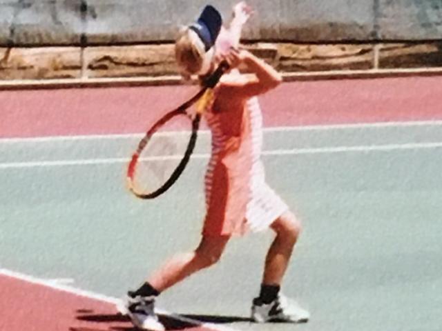 Chloe Lee as a little girl swinging a tennis racket