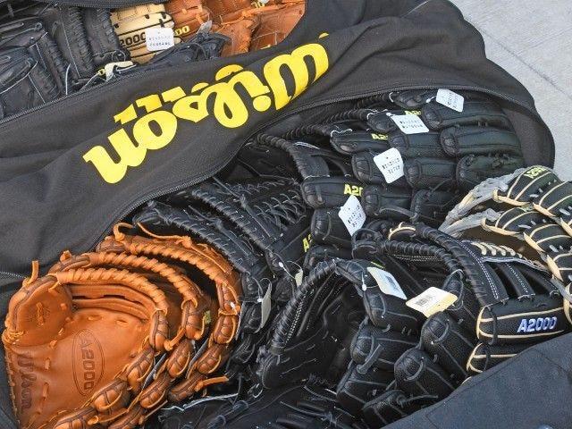 bags of Wilson ball gloves