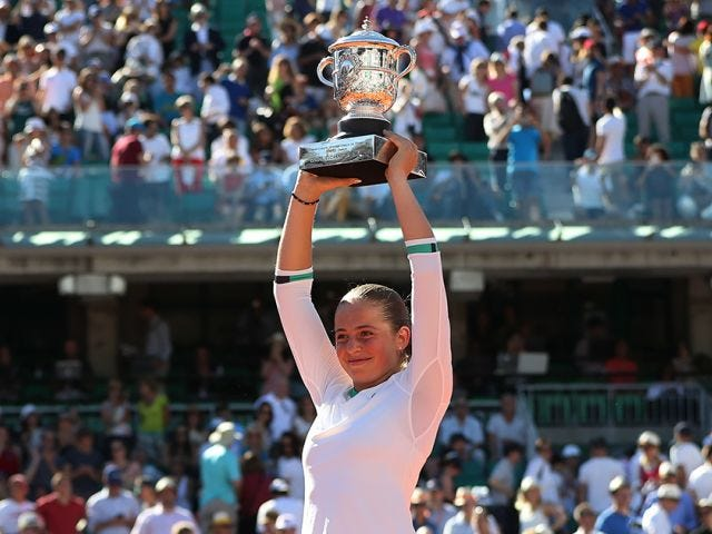 A player at Roland Garros holding up trophy