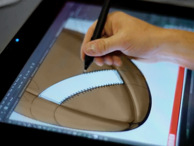 Image of a football on a digital tablet with hand drawing it