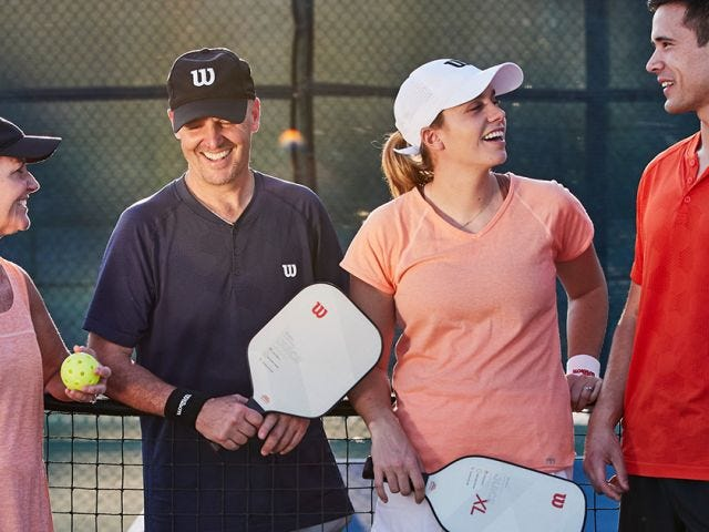 Pickleball players playing pickleball