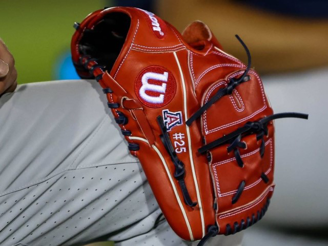 Closeup of Wilson glove with the Arizona State logo on it