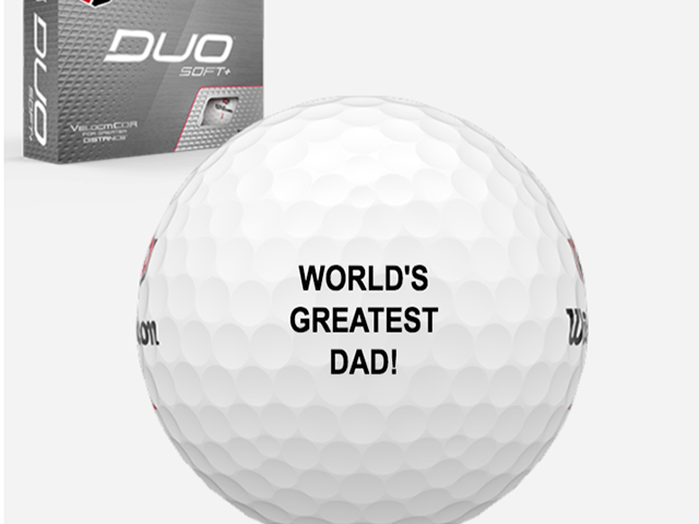 """closeup of a personalized golf ball that says """"world's greatest dad"""""""