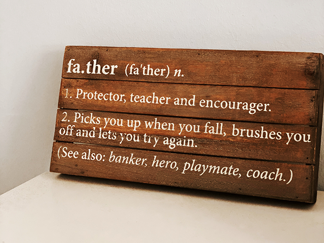 wooden board with definition of father on it