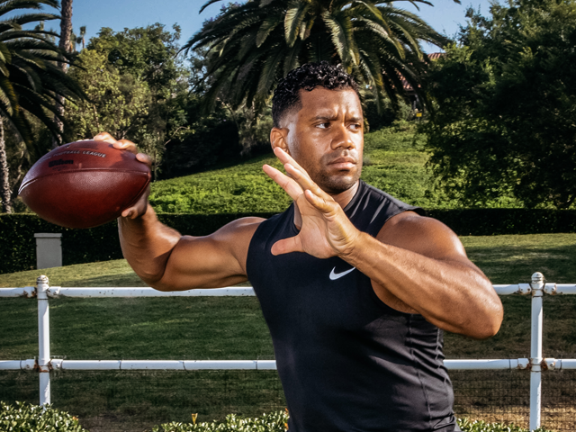 Russell Wilson pulls the ball back for a pass