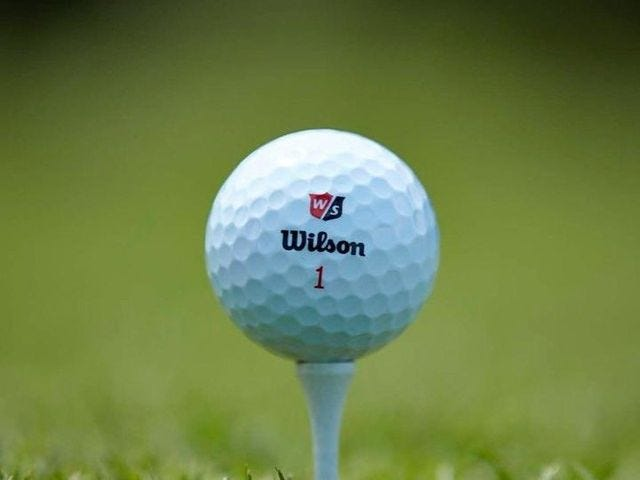 close up of golf ball on a tee