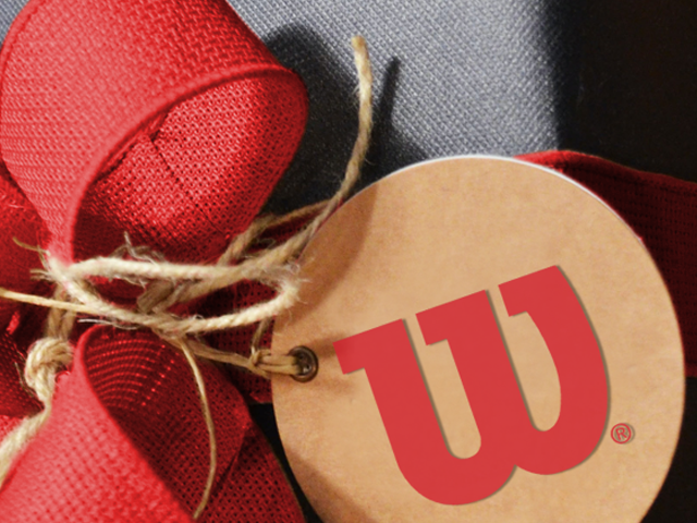 closeup of a tan gift tag with a Wilson logo