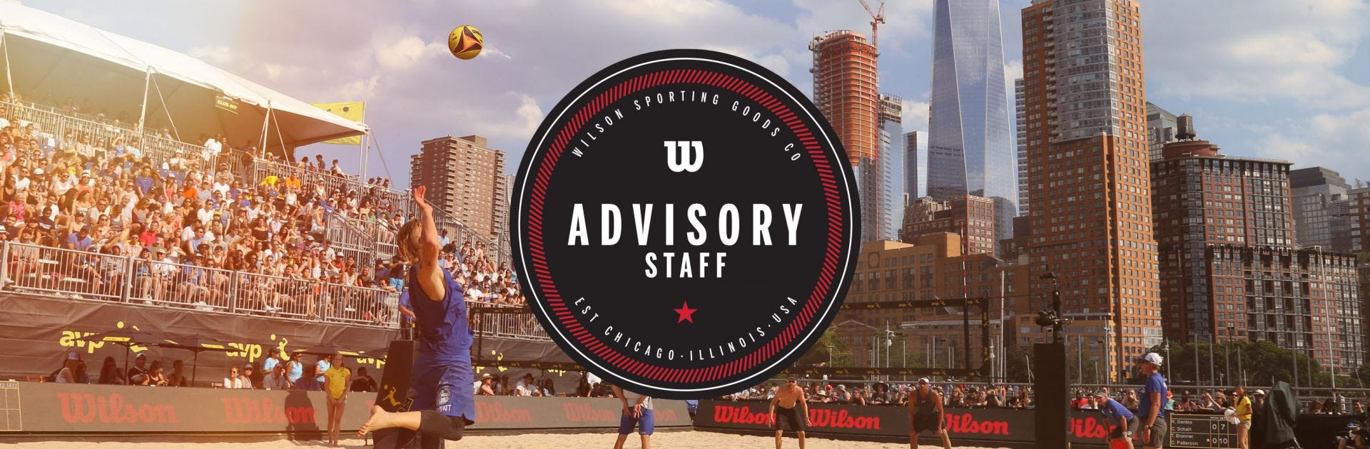 Advisory Staff Logo in foreground of beach volleyball court
