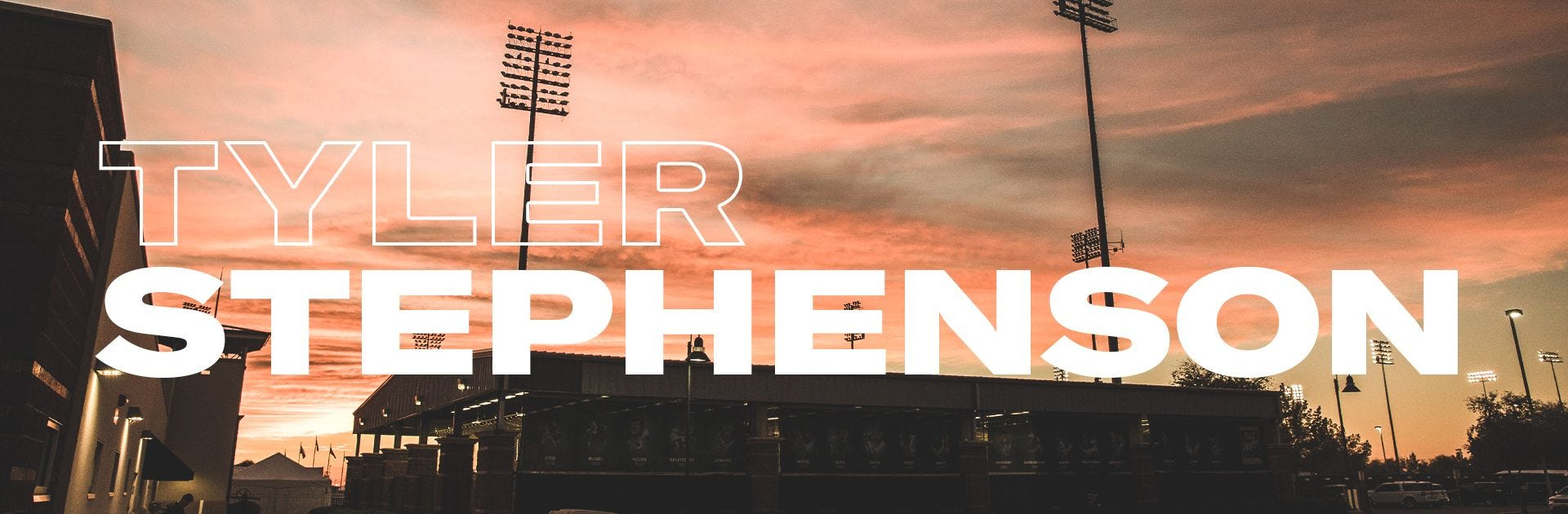 "Baseball field at sunset with ""Stephenson"" text overlaid"