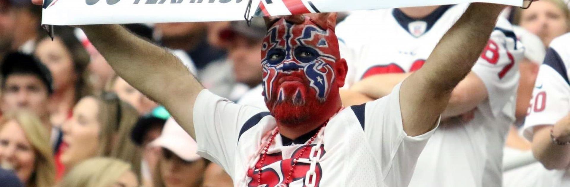 Super fan Houston Maul holding sign