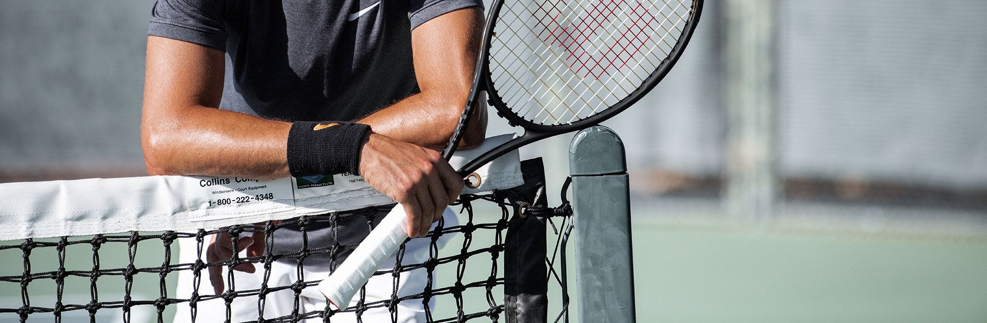 close-up of a player gripping  their racket on court