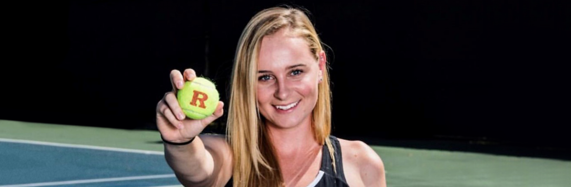 Chloe Lee holds out a tennis ball to the reader