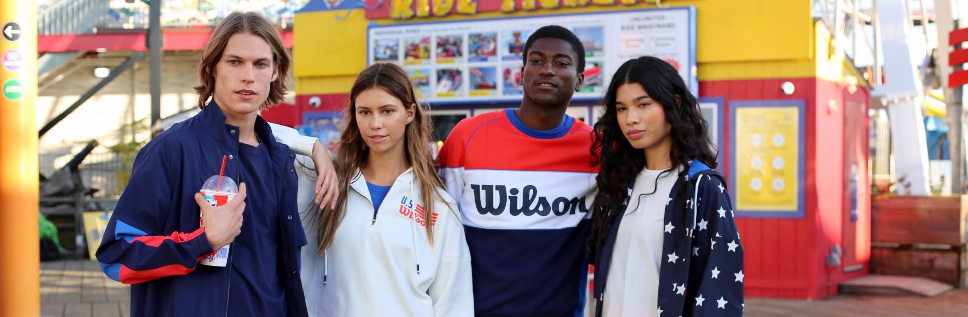 people on a boardwalk wearing wilson sportswear