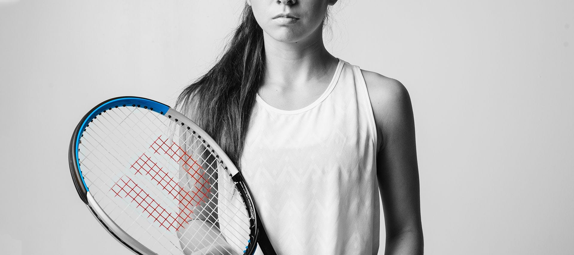 Tennis player holding Ultra v3 racquet