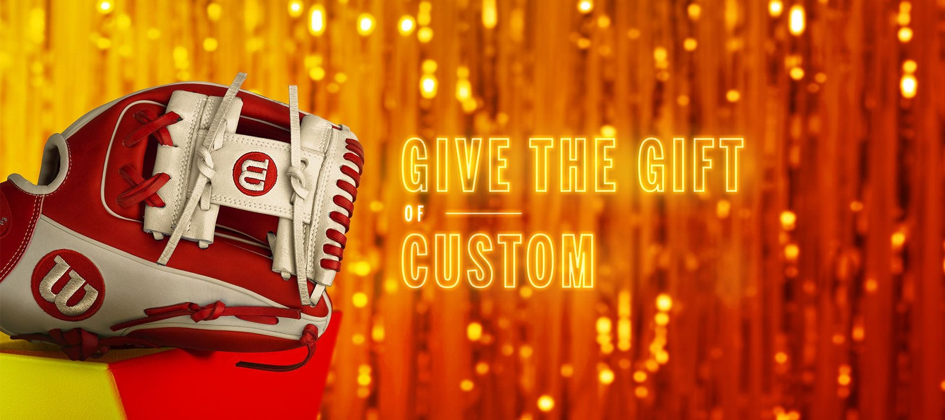 Give the Gift of Custom, neon writing featuring a red Wilson custom baseball glove