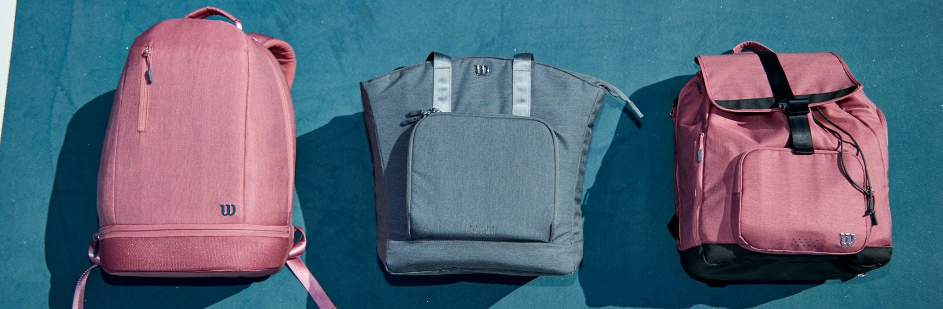 Womens Tennis Bag range laid on tennis court