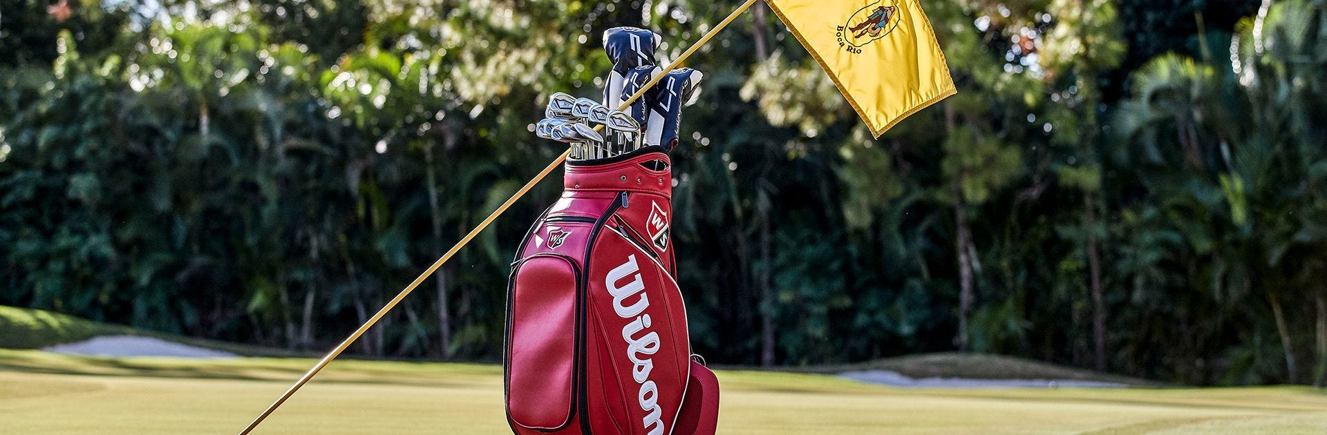 Pin flag resting on Wilson Golf bag
