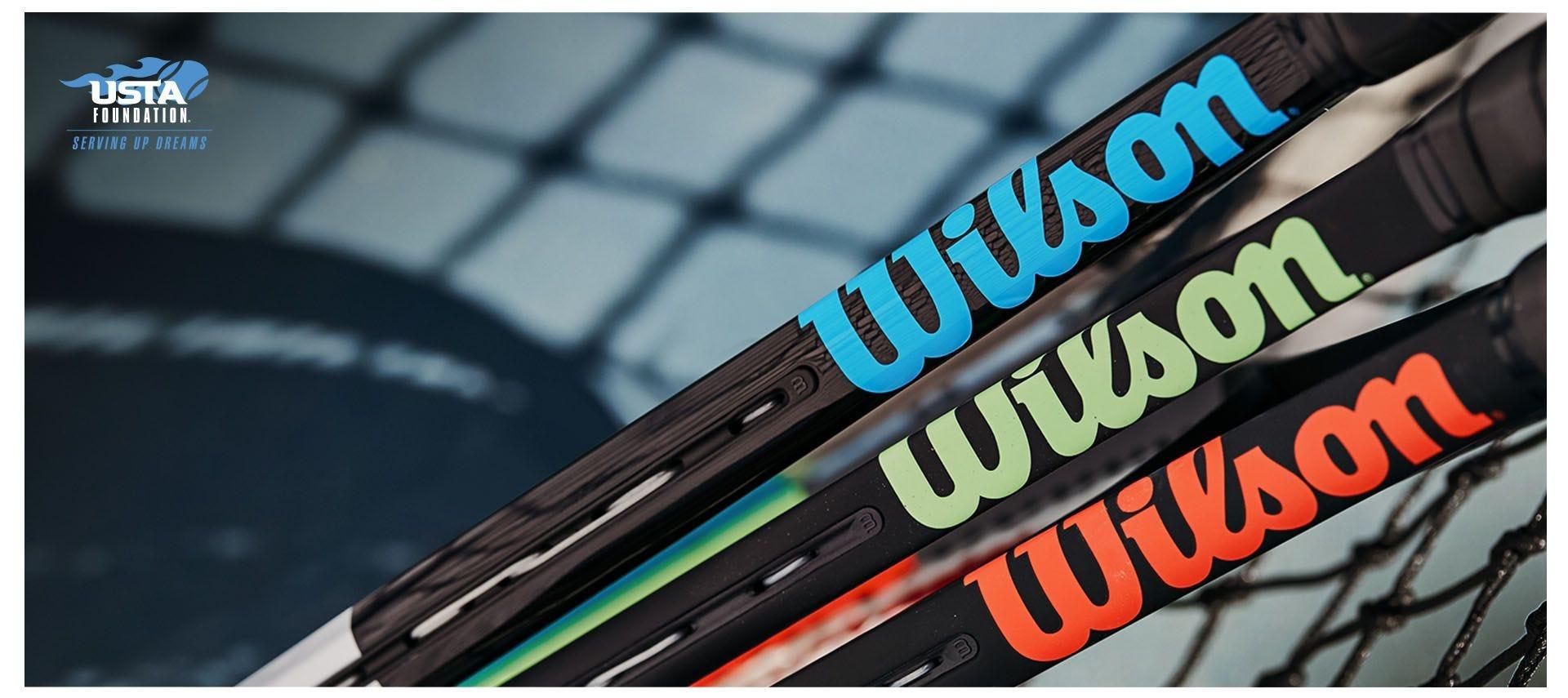 Lineup of WIlson rackets against a net