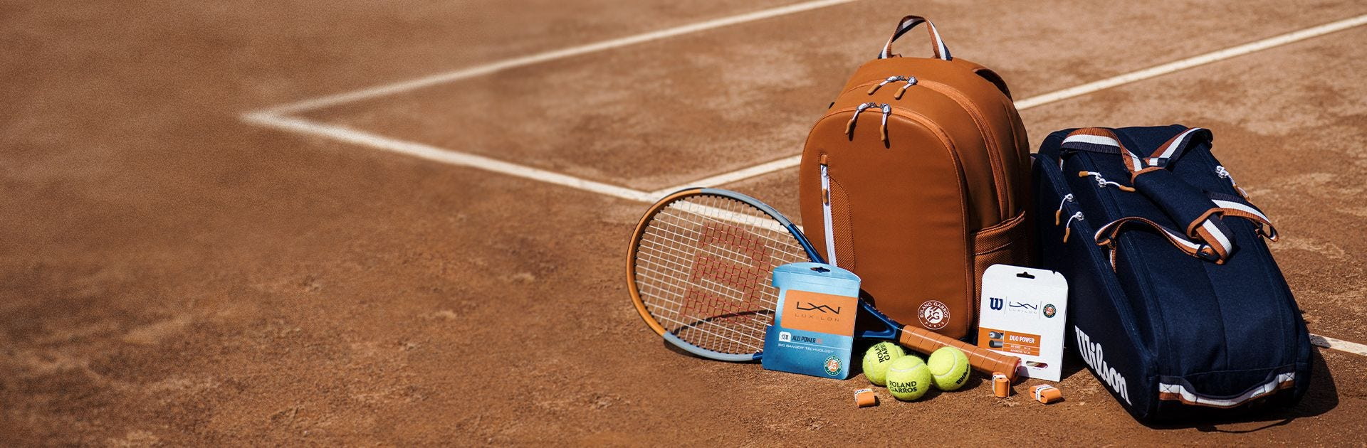 Roland Garros Collection items on a tennis court