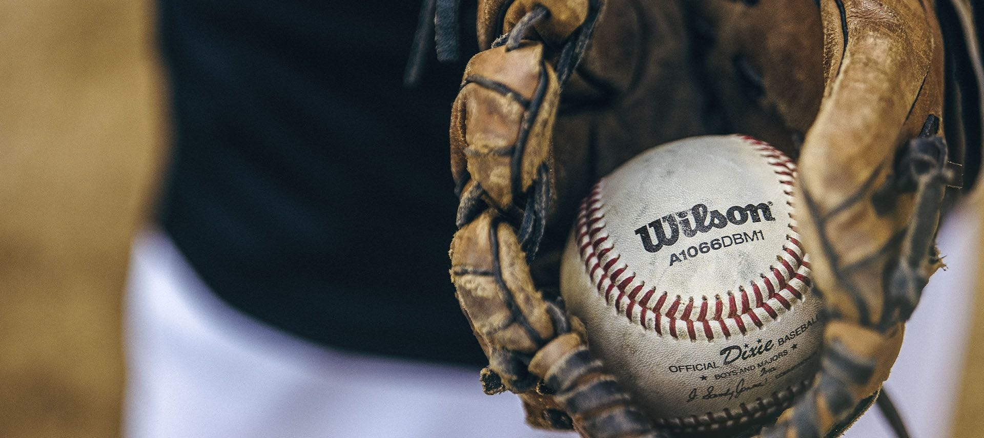 Close up of a ball in a baseball glove