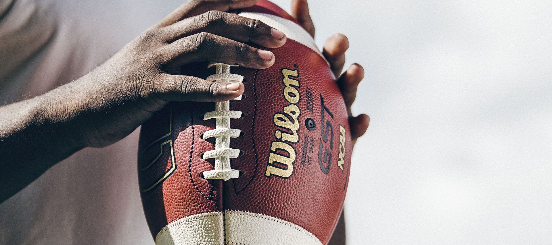 Close up of a player preparing to throw a football