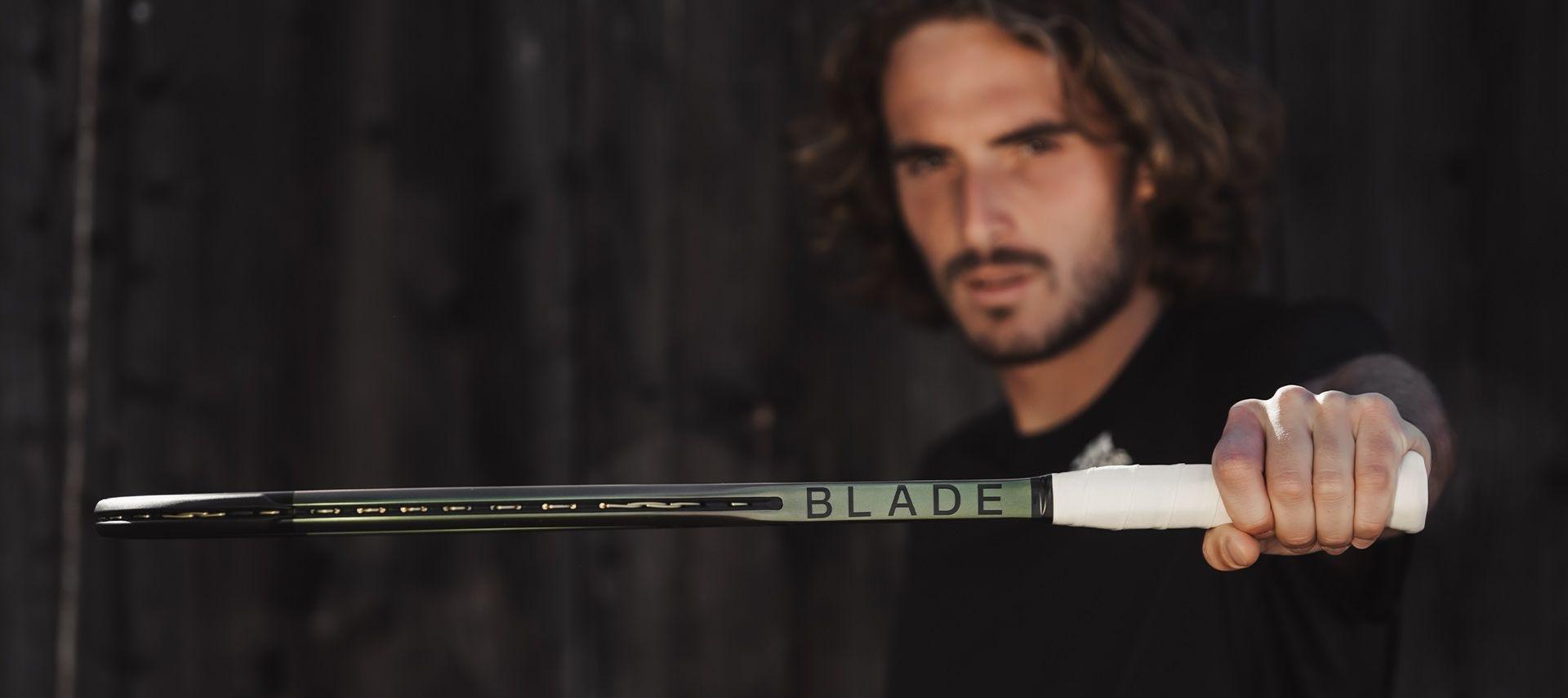 Stefanos Tsitsipas holding a blade v8