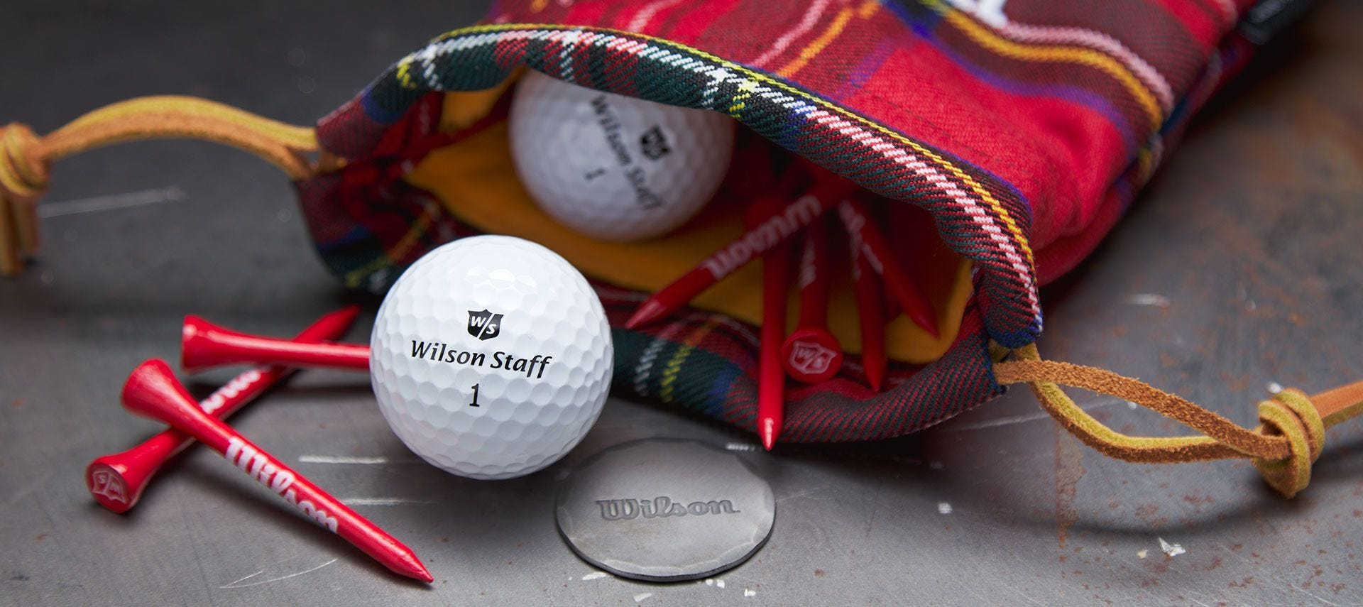 Seamus x Wilson pouch holding balls and tees