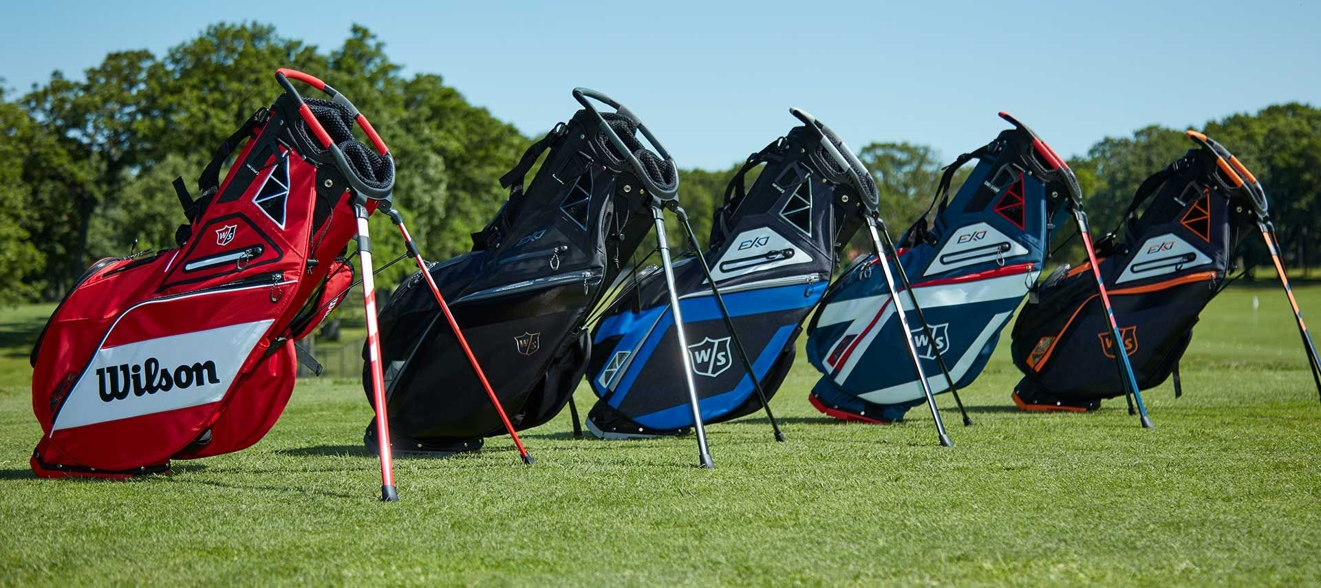 Five colorways or EXO Carry bags on a golf course