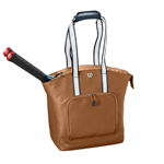 tan bag with tennis rackets in it